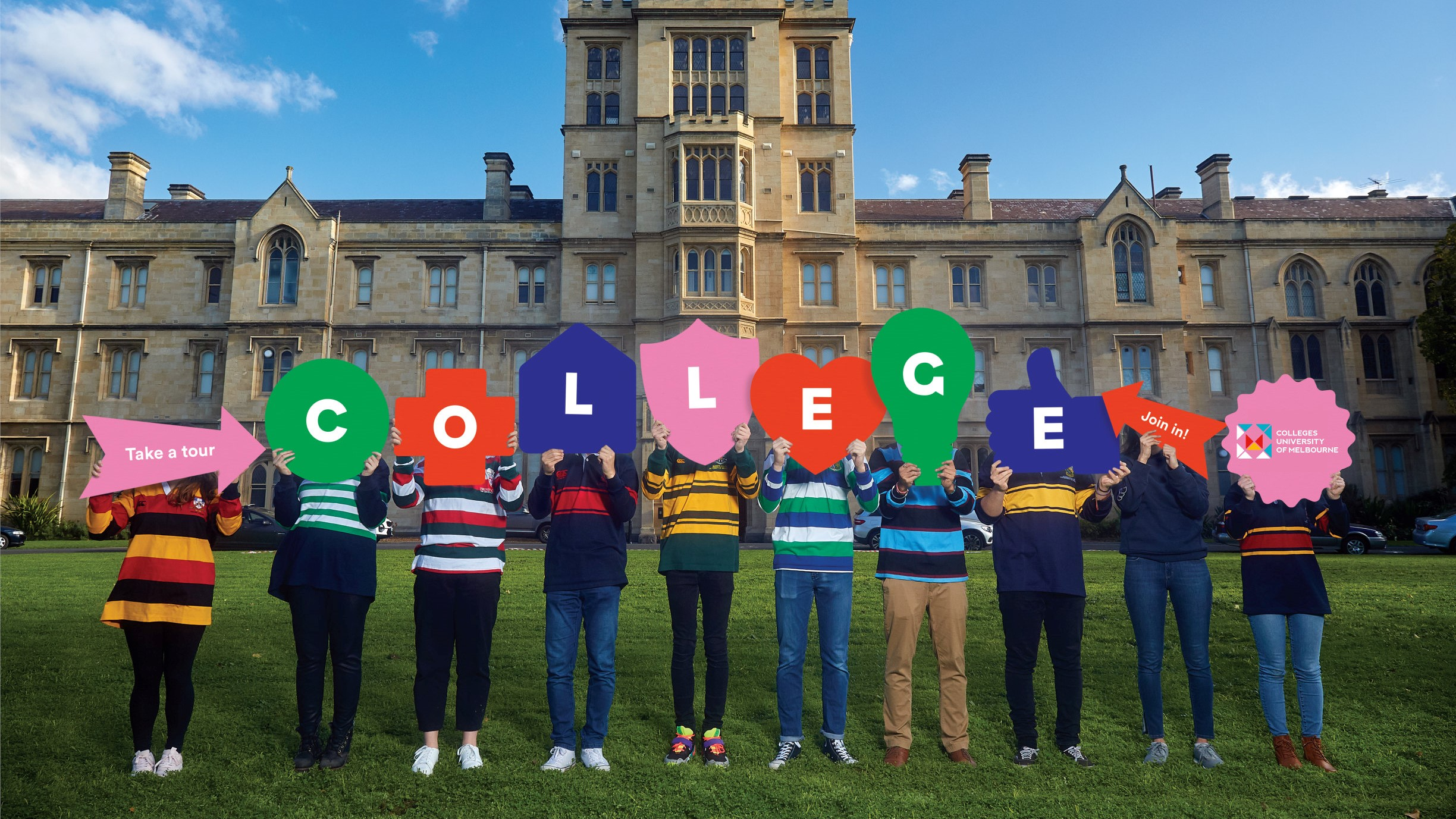 students in rugby tops holding colourful signs outside of a college